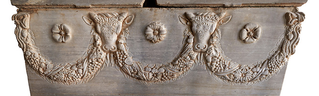 Roman relief sculpted garland sarcophagus with reliefs of bulls heads and garlands, 2nd century AD. Adana Archaeology Museum, Turkey. Against a white background