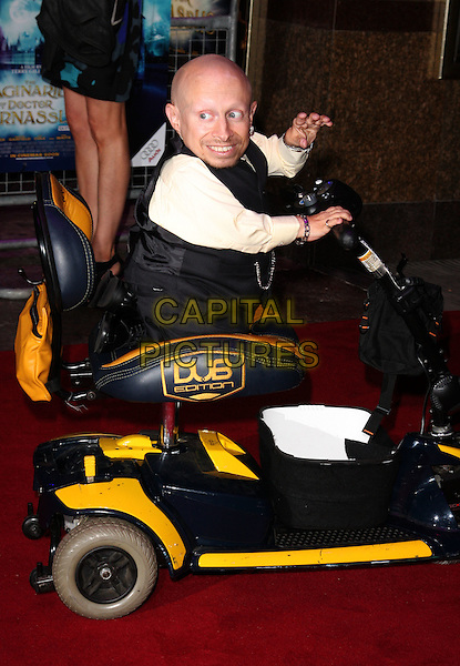 "VERNE TROYER .Attending the UK film premiere of ""The Imaginarium Of Doctor Parnassus"" at the Empire Leicester Square cinema, London, England, UK, October 6th 2009..full length sitting riding driving hand waving scooter electric pale yellow shirt grey gray waistcoat DUB edition .CAP/ROS.©Steve Ross/Capital Pictures"