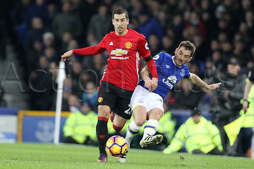 04.12.2016. Goodison Park, Liverpool, England. Premier League Football. Everton versus Manchester United. Leighton Baines of Everton passes the ball forward as Henrikh Mkhitaryan of Manchester United attempts to block him.