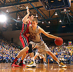 BROOKINGS, SD - MARCH 1:  Marcus Heemstra #32 from South Dakota State University backs down Tyler Flack #23 from the University of South Dakota in the second half or their game Saturday afternoon at Frost Arena in Brookings. (Photo by Dave Eggen/Inertia)