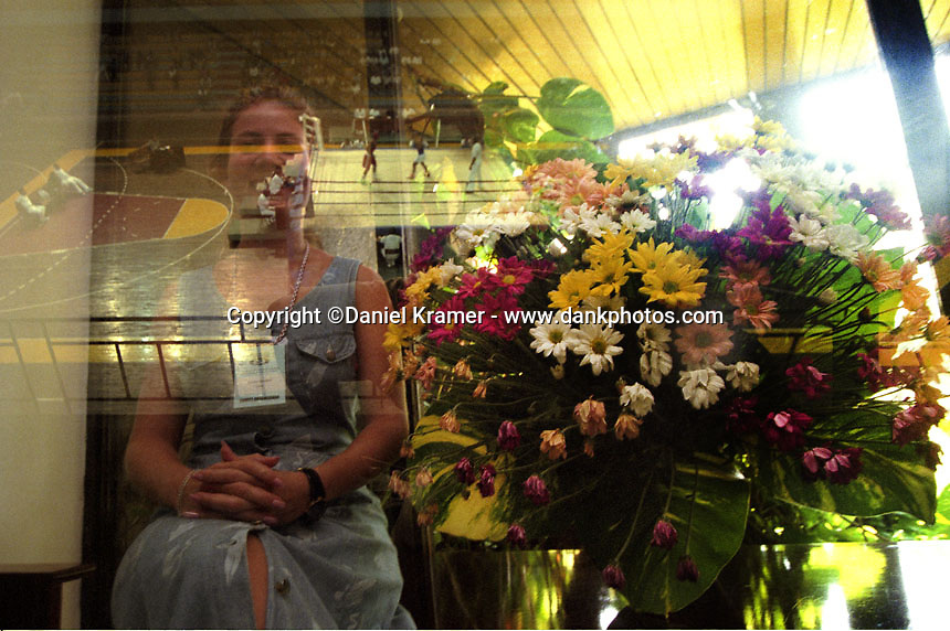 Double exposure showing boxers at the Kid Chocolate Boxing Center and an unknown woman with flowers in Havana, 1998.