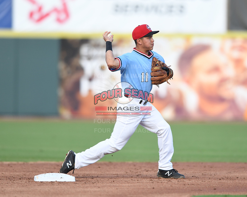 Hickory Crawdads Frainyer Chavez (11) throws to first to complete the double play during a game with the Asheville Tourists at L.P. Frans Stadium on May 8, 2019 in Hickory, North Carolina.The Tourists defeated the Crawdads 7-6. (Tracy Proffitt/Four Seam Images)