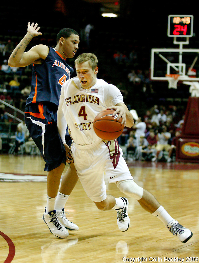 TALLAHASSEE, FL 12/11/09-FSU-AU BB09 CH05-Florida State's Deividas Dulkys, right, drives by Auburn's Lucas Hargrove during first half action Thursday at the Donald L. Tucker Center in Tallahassee...COLIN HACKLEY PHOTO
