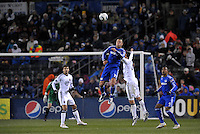Jack Jewsbury (blue) out jumps Carey Talley...Kansas City Wizards defeated D.C Utd 4-0 in their home opener at Community America Ballpark, Kansas City, Kansas.