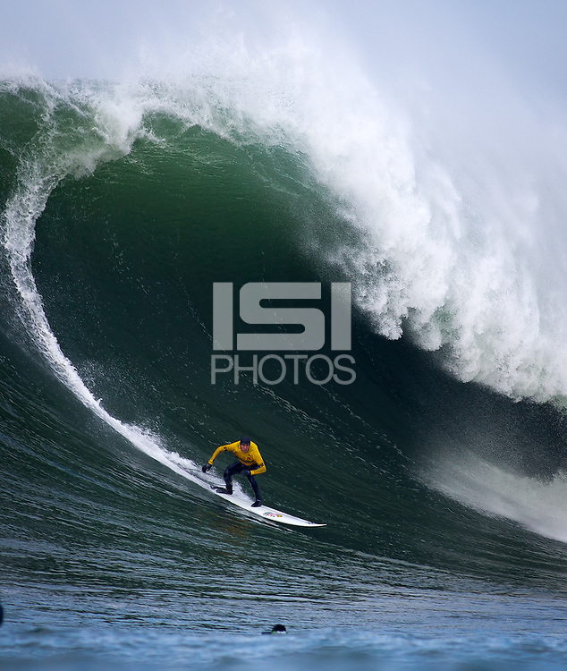 Half Moon Bay, California - January 24, 2014: 2014 Maverick's Invitational Greg Long with a nice drop in.