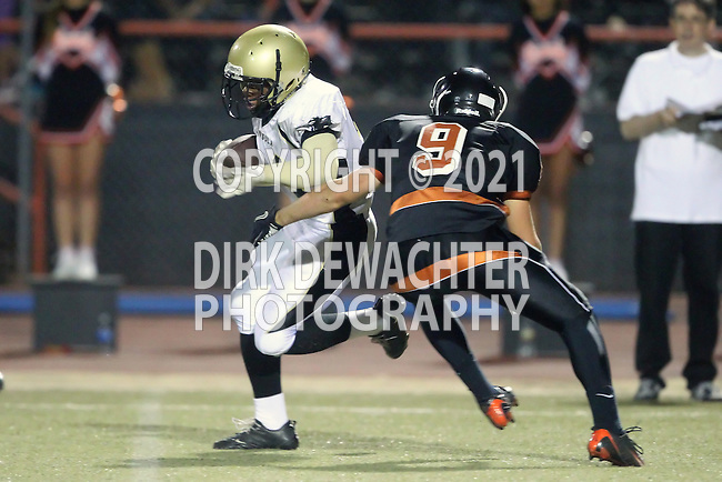 Beverly Hills, CA 09/23/11 - Okuoma Idah (Peninsula #24) and Patrick Nollinger (Beverly Hills #9) in action during the Peninsula-Beverly Hills Varsity football game.