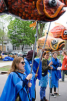 Fish puppeteers representing the creatures that swim in the water. MayDay Parade and Festival. Minneapolis Minnesota USA