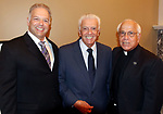 WATERBURY CT. 17 July 2017-071717SV05-From left, Attorney Ron Ferraro of Waterbury, nephew, Dr. Robert Ferraro of Waterbury, brother, and Rev. Anthony Bruno attend a dinner to honor the retiring Rev. Ronald Ferraro at La Bella Vista in Waterbury Monday. After 57 years of service, the Rev. Ferraro will retire as pastor of Our Lady of Lourdes Church, where he has served since 1990.<br /> Steven Valenti Republican-American