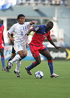 Marinao Acevedo (left) chases after Fabrice Noel (right). Honduras defeated Haiti 1-0 during the First Round of the 2009 CONCACAF Gold Cup at Qwest Field in Seattle, Washington on July 4, 2009.