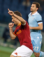 Calcio, Serie A: Roma vs Lazio. Roma, stadio Olimpico, 8 aprile 2013..AS Roma forward Francesco Totti celebrates after scoring on a penalty kick during the Italian Serie A football match between AS Roma and Lazio at Rome's Olympic stadium, 8 April 2013..UPDATE IMAGES PRESS/Riccardo De Luca