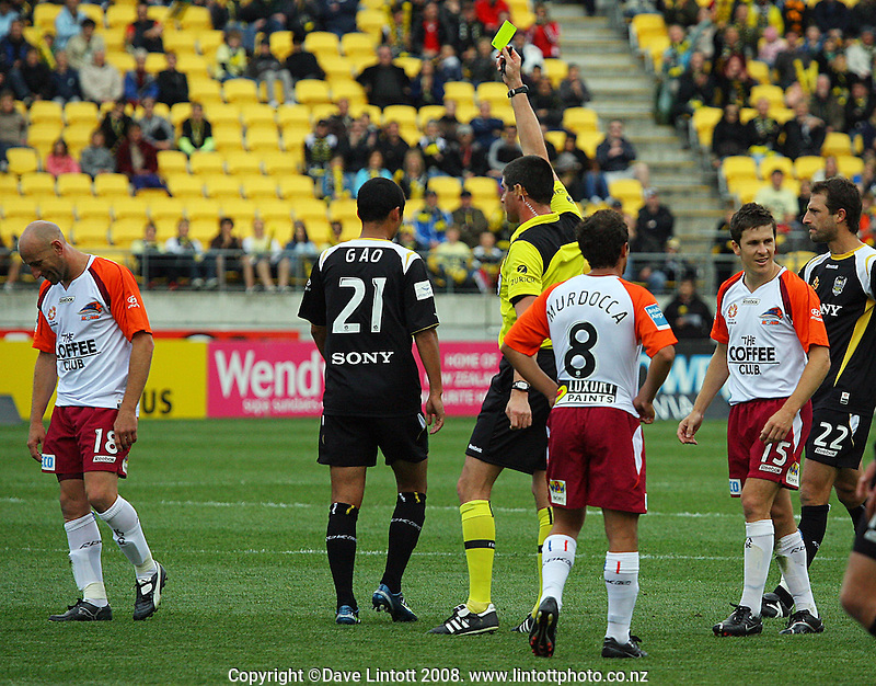 Danny Tiatto is yellow-carded during the A-League football match between the Wellington Phoenix and Queensland Roar at Westpac Stadium, Wellington. Sunday, 26 October 2008. Photo: Dave Lintott / lintottphoto.co.nz
