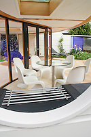 Covered patio, modern upscale. NR36 Flemings Nurseries Australian Garden.Outdoor lifestyle garden Design: Dean Herald.Outdoor Lifestyle, modern, chimney and fireplace