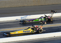 Apr. 13, 2012; Concord, NC, USA: NHRA top fuel dragster driver SPencer Massey (near) leads Hillary Will during qualifying for the Four Wide Nationals at zMax Dragway. Mandatory Credit: Mark J. Rebilas-