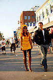 USA, Los Angeles, individuals walking down the Venice Boardwalk