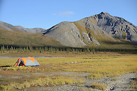 Campers preparing to float The Sheenjek River set up their tent in  Alaska's Brooks Range near Ambresvajun (Last) Lake in the Arctic National Wildlife Refuge in late August.