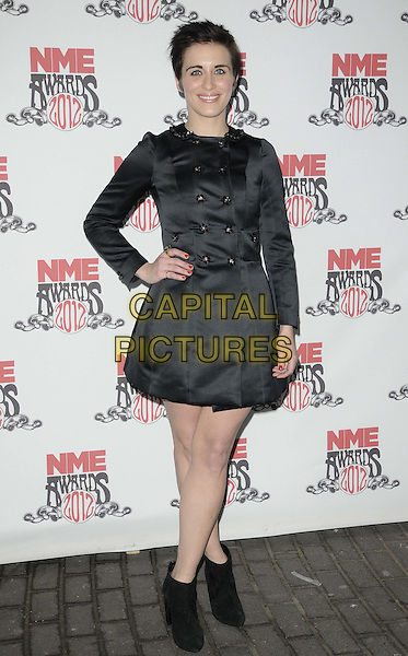 Vicky McClure.attended the NME Awards 2012, O2 Academy Brixton, Stockwell Rd., London, England.February 29th, 2012.full length black dress jacket coat  hand on hip ankle boots .CAP/CAN.©Can Nguyen/Capital Pictures.