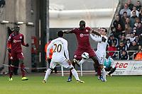 Saturday 2nd March 2013<br /> Pictured: (L-R) Jonathan de Guzman, Moussa Sissoko, Leon Britton.<br /> Re: Barclays Premier Leaguel, Swansea  v Newcastle at the Liberty Stadium in Swansea.