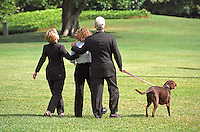 "28 October 2016 - File Photo: ""Buddy"" the dog leads the First Family to Marine 1 on the South Lawn of the White House on August 19, 1999.  The Clintons are to vacation for 2 weeks in Martha's Vineyard.  From left to right: First lady Hillary Rodham Clinton, Chelsea Clinton, United States President Bill Clinton, ""Buddy"" the dog. On Tuesday, August 17, 1999, the President testified before the Grand Jury on his involvement in the Monica Lewinsky scandal and subsequently made a nationally televised statement admitting he had an inappropriate relationship with Ms. Lewinsky. Photo Credit: Ron Sachs/CNP/AdMedia"