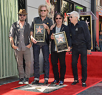 LOS ANGELES, CA. September 2, 2016: Dave Stewart (left) with Daryl Hall &amp; John Oates &amp; Jerry Greenberg at the Hollywood Walk of Fame star ceremony honoring musicians Daryl Hall &amp; John Oates. <br /> Picture: Paul Smith / Featureflash