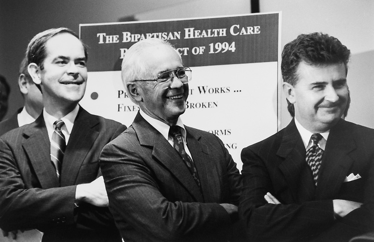 A bi-partisan group holds a press conference to discuss their Healthcare Bill. About 30 members of Congress were present. Here, Rep. J. Roy Rowland, D-Ga., Jim Cooper, D-Tenn., and Rep. Fred Grandy, R-Iowa, on Aug. 11, 1994. (Photo by CQ Roll Call)