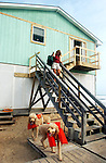Terry Cargill begins evacuating her waterfront 'dream home' at Kitty Hawk behind her two French poodles Romeo and Valentino (in  flotation vests).  Cargill planned to weather the storm about 4 blocks inland at a condominium with friends and family.
