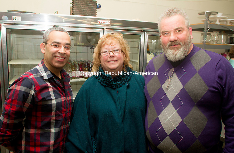 WATERBURY, CT.- 08 MARCH 2015 - 030815JW08 - Raul Lopez, Dawn Slavinski and Peter Slavinski pose for a photo during Sweet Maria's bakery's 25th anniversary celebration Sunday afternoon.<br /> Jonathan Wilcox Republican-American
