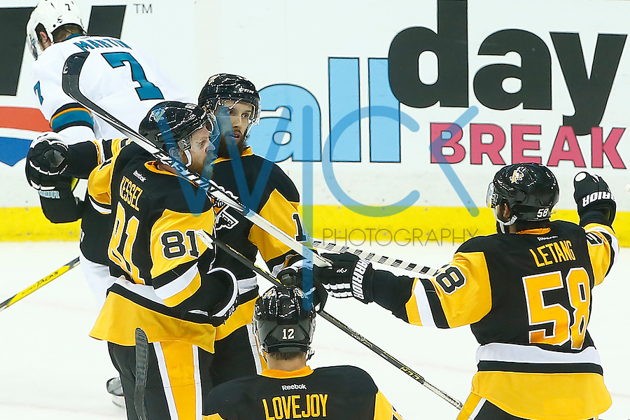 Nick Bonino #13 of the Pittsburgh Penguins celebrates his game-winning goal with teammate Phil Kessel #81 of the Pittsburgh Penguins in the third period past Martin Jones #31 of the San Jose Sharks during game one of the Stanley Cup Final at Consol Energy Center in Pittsburgh, Pennslyvania on May 30, 2016. (Photo by Jared Wickerham / DKPS)