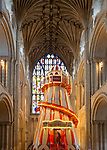 Traditional helter skelter fairground ride inside cathedral church at Norwich, Norfolk, England, UK - August 2019