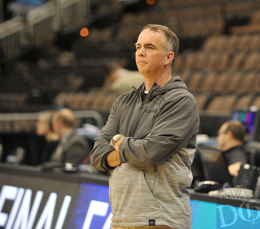 NWA Democrat-Gazette/Michael Woods --03/15/2015--w@NWAMICHAELW... Wofford head coach Mike Young watches his team practice Wednesday evening at Jacksonville Veterans Memorial Arena in Jacksonville, Florida.