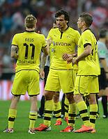 FUSSBALL   1. BUNDESLIGA   SAISON 2012/2013   SUPERCUP FC Bayern Muenchen - Borussia Dortmund            12.08.2012 Enttaeuschung nach der Niederlage, Marco Reuss, Mats Hummels, Lukasz Piszczek (v. li., Borussia Dortmund)