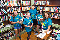 Freshmen Claire Wulfman, Bridget Hayden, Thor Brochu, Emma Kiely and Eveyln Alejandro work together to scan and organize books at the Redwood Library as they take part in the Salve Regina University Exploration Day of Service in Newport.