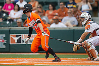 Oklahoma State Cowboys outfielder Conor Costello #24 follows through on his swing during the NCAA baseball game against the Texas Longhorns on April 26, 2014 at UFCU Disch–Falk Field in Austin, Texas. The Cowboys defeated the Longhorns 2-1. (Andrew Woolley/Four Seam Images)