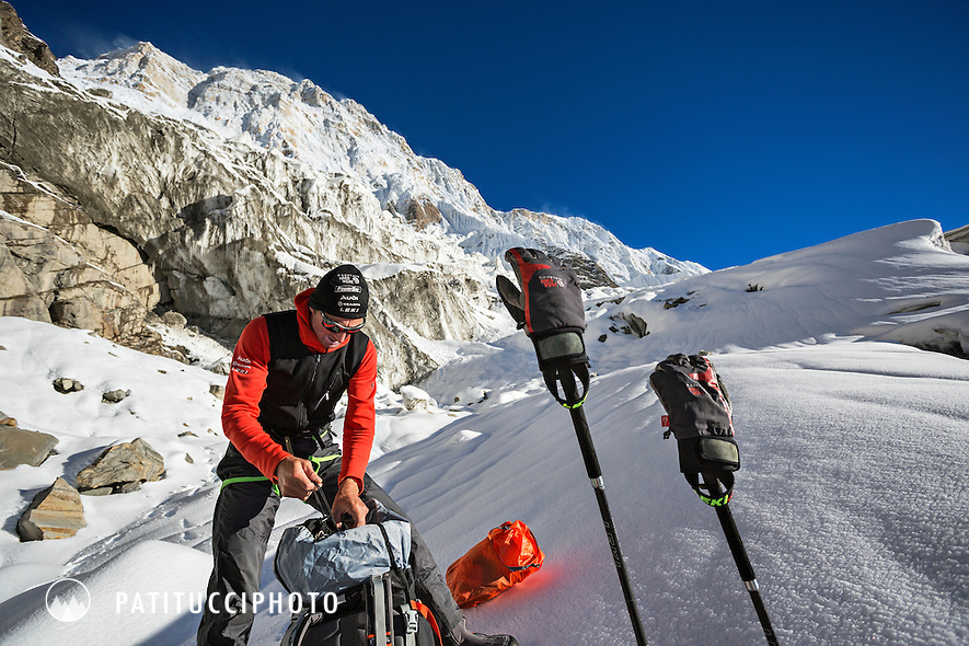 Ueli Steck returned to Nepal and the Annapurna south face in 2013 which he climbed solo, without oxygen, in one 28 hour alpine push, via a new route. The trip was his third attempt to climb the 8000 meter peak. Ueli stopped and preparing his gear while approaching the south face on the  glacier.