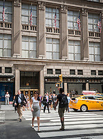 The Saks Fifth Avenue flagship store in New York on Wednesday, July 31, 2013.  Saks has agreed to a sale of itself to the Hudson's Bay Co., a luxury retailer who also owns Lord & Taylor. The sale is reported to be about $2.4 billion.  (© Richard B. Levine)