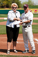 Coach Keith Guttin (2) presents a check to the director of Greene County Park and Recreation prior to a game against the Wichita State Shockers on April 9, 2011 at Hammons Field in Springfield, Missouri.  Photo By David Welker/Four Seam Images.