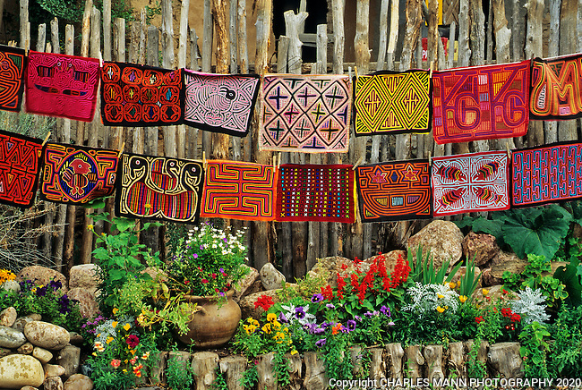 The gardens of Santa Fe,New Mexico, offer a constant suppply of delightful surprises and artful delights. A  stirng of Mexica molas for sale on Canyon Road is just another arty dash of color in a colorful town.
