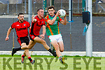 Gavan O'Grady  Mid Kerry gets to the ball ahead of Mark Crowley and Dara Crowley Kenmare during their SFC quarter final in Fitzgerald Stadium on Sunday