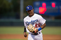 AZL Dodgers left fielder Kevin Aponte (49) jogs off the field between innings of an Arizona League game against the AZL White Sox at Camelback Ranch on July 3, 2018 in Glendale, Arizona. The AZL Dodgers defeated the AZL White Sox by a score of 10-5. (Zachary Lucy/Four Seam Images)