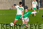 Philip Lucid Ballyduff getting a leg in ahead of Jack Gogarty Ballydonoghue at the North Kerry Championship semi final played in Ballybunion on Sunday