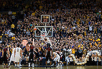 California fans try to distract Dwight Powell of Stanford's shot during the game at Haas Paviliion in Berkeley, California on March 6th, 2013.  Stanford defeated California, 83-70.