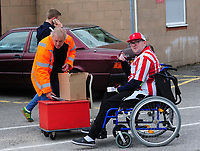 A Lincoln City fan buys a programme before kick off<br /> <br /> Photographer Andrew Vaughan/CameraSport<br /> <br /> The EFL Sky Bet League Two - Lincoln City v Morecambe - Saturday August 12th 2017 - Sincil Bank - Lincoln<br /> <br /> World Copyright &copy; 2017 CameraSport. All rights reserved. 43 Linden Ave. Countesthorpe. Leicester. England. LE8 5PG - Tel: +44 (0) 116 277 4147 - admin@camerasport.com - www.camerasport.com