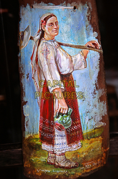 Painting of Bulgarian lady on ceramic pottery base outside gift and craft shop, Veliko Tarnovo, Bulgaria