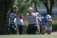 Nelly Korda (USA) and Brooke M. Henderson (CAN) look back through the trees as they wait to putt during round 1 of the 2019 US Women's Open, Charleston Country Club, Charleston, South Carolina,  USA. 5/30/2019.<br /> Picture: Golffile | Ken Murray<br /> <br /> All photo usage must carry mandatory copyright credit (© Golffile | Ken Murray)
