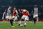 Arsenal's Alexis Sanchez tussles with West Brom's Jonny Evans during the premier league match at the Emirates Stadium, London. Picture date 25th September 2017. Picture credit should read: David Klein/Sportimage