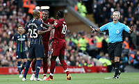 Liverpool's Georginio Wijnaldum separates Sadio Mane and Manchester City's Fernandinho following an altercation while Referee Martin Atkinson makes his way over<br /> <br /> Photographer Rich Linley/CameraSport<br /> <br /> The Premier League - Liverpool v Manchester City - Sunday 7th October 2018 - Anfield - Liverpool<br /> <br /> World Copyright &copy; 2018 CameraSport. All rights reserved. 43 Linden Ave. Countesthorpe. Leicester. England. LE8 5PG - Tel: +44 (0) 116 277 4147 - admin@camerasport.com - www.camerasport.com