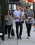 """January 29th 2011  Saturday ..kourtney kardashian carrying a big huge black purse handbag while going to lunch at Joans on third restaurant in Beverly Hills California. K was  Drinking ice t wearing a dress shirt with reindeer print or some type of animal deer looking creatures all over it.  The baby Mason dash made a few funny faces with his mouth was wide open in surprise doing the """"Home Alone"""" style face. For the first time Scott Disick wasn't wearing a suit but sure did have a nice gold watch on. ..AbilityFilms@yahoo.com.805-427-3519.www.AbilityFilms.com."""