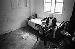 Shatila, UNRWA camp. Kheir Mohsen lives in a 2 room appartment inside the camp. In the bedroom, Kheir Mohsen's mother-in-law peels 3rd grade potatoes from the vegetable market at Sabra.<br />  <br /> Chatila, camp de l'UNRWA. Kheir Mohsen vit avec sa famille dans un deux pi&egrave;ces &agrave; l'int&eacute;rieur du camp. Dans la pi&egrave;ce qui sert de chambre, la belle-m&egrave;re de Kheir Mohsen &eacute;pluche des pommes-de-terre de troisi&egrave;me cat&eacute;gorie r&eacute;cup&eacute;r&eacute;es au march&eacute; de l&eacute;gumes de Sabra.