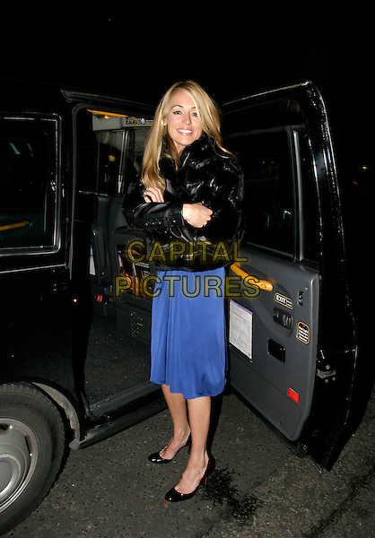 CAT DEELEY.Mikimoto: Shades of Black - launch party, W1, London, UK..October 26th, 2005.Ref: AH.full length blue dress black jacket car cab taxi.www.capitalpictures.com.sales@capitalpictures.com.© Capital Pictures.
