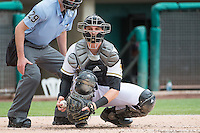Jett Bandy (27) of the Salt Lake Bees on defense against the Tacoma Rainiers in Pacific Coast League action at Smith's Ballpark on May 7, 2015 in Salt Lake City, Utah. The Bees defeated the Rainiers 11-4 in the completion of the game that was suspended due to weather on May 6, 2015.(Stephen Smith/Four Seam Images)