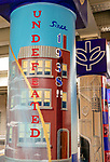 The &quot;Undefeated Since 1938&quot; mural under the Fullerton &quot;L&quot; Station in Lincoln Park. Brother Mark Elder, C.M., an adjunct faculty member in DePaul&rsquo;s art, media and design program, has lead the charge to install murals under the Fullerton &quot;L&quot; Station in Lincoln Park that highlight DePaul University's history. <br /> <br /> Elder's artistic retrospective, titled &ldquo;The Story of &lsquo;The Little School Under the &lsquo;L&rsquo;&rsquo;, will eventually feature 25 murals permanently installed on the massive concrete pillars that support the &quot;L&quot; station nearest the university's Lincoln Park Campus. (DePaul University/Jamie Moncrief)